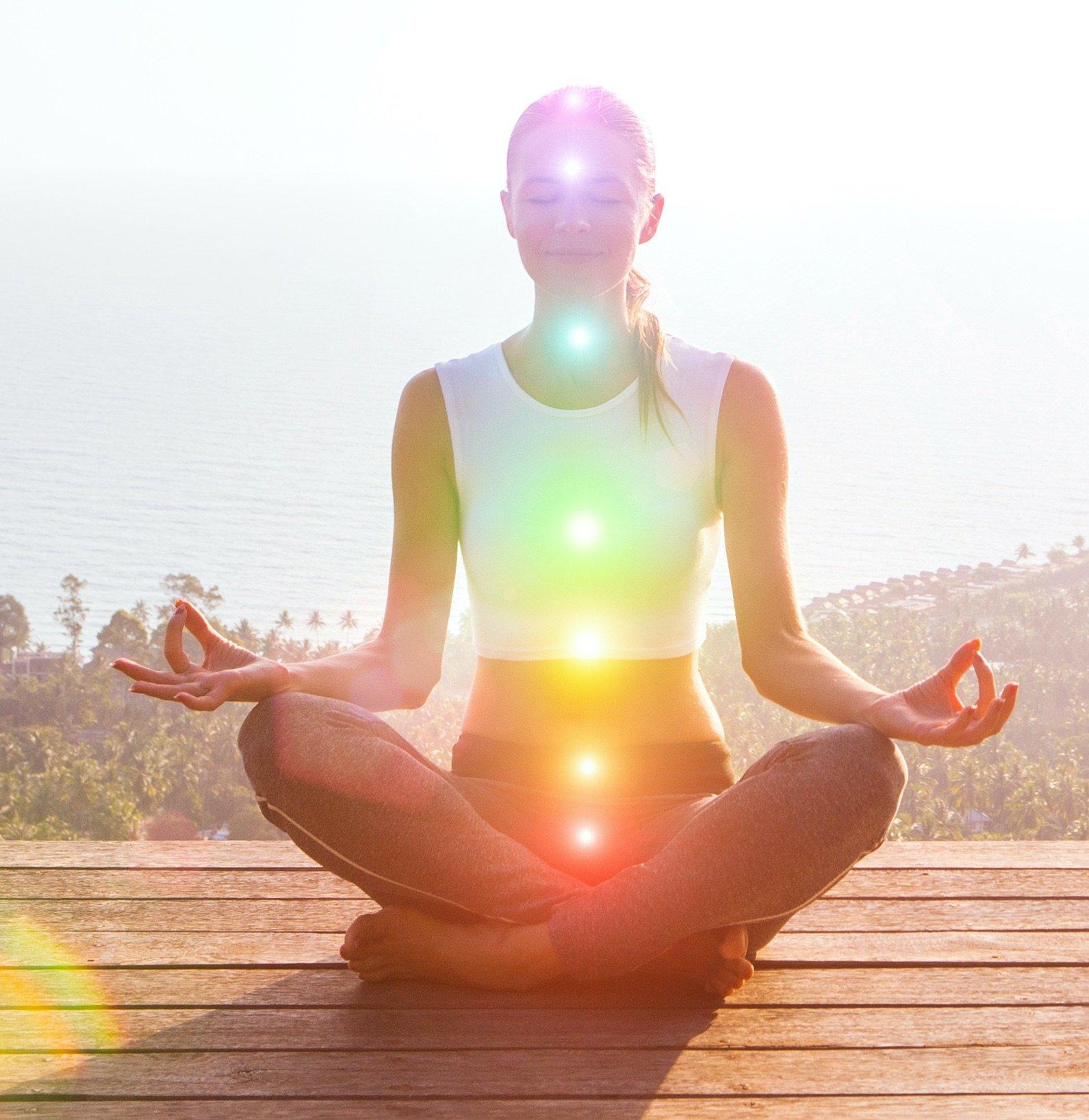 Woman Meditating Chakras